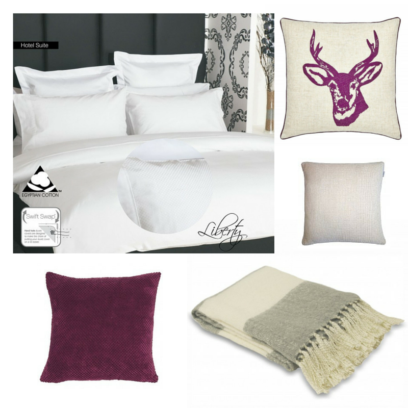 crisp ivory bedding with grey trim throw and stag statement cushion