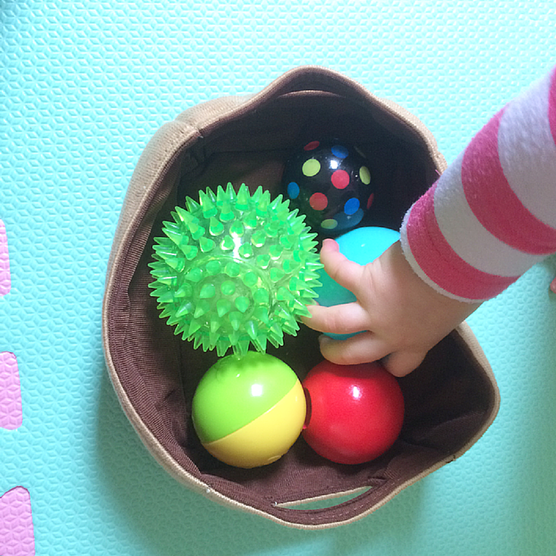 Different textured balls basket. A quick and easy baby sensory activity
