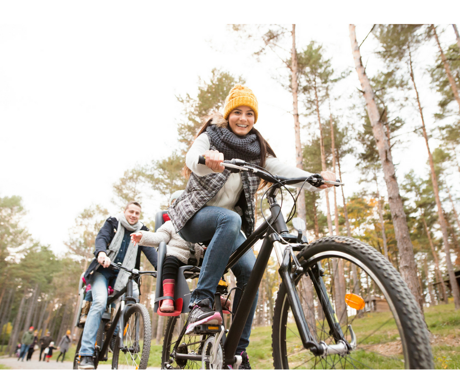 fun ways to exercise a family a family taking a bike ride with two young children,